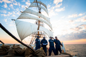 "Seaman Shaniqua Bennett, a full time crewmember on Coast Guard Cutter Eagle, instructs Cadets 4th class Micaela Martineli, Chris Nadeau, and Gary Nelthropp, about the requisites of standing lookout watch at the forecastle in the North Atlantic, May 9, 2016. The lookouts are vital to safe navigation as they are the ""eyes and ears"" of Eagle. U.S. Coast Guard photo by Petty Officer 2nd class LaNola Stone."